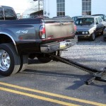 Pick up truck with automatic wheel lift equipment hooked on.