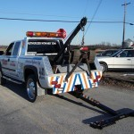 Hidden wheel lift deployed from a tow truck