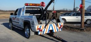 Professional tow truck has a wheel lift system deployed