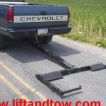 Chevolet truck converted into a tow truck with a hidden wheel lift system.
