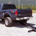 Pickup truck with a wheel lift system deployed.