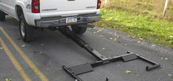 Pickup truck has lift and tow 3 series installed for towing.