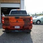 A hidden wheel lift installed under a pickup truck