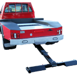 Lift and tow hidden wheel lift attached to a pickup truck