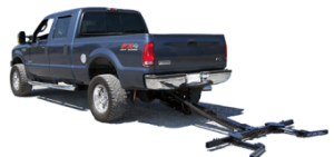 A hidden wheel lift installed and deployed on a truck