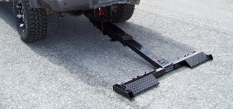 Hidden wheel lift for tow trucks that lift cars up and down.