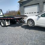 Our tow product in action towing a white car
